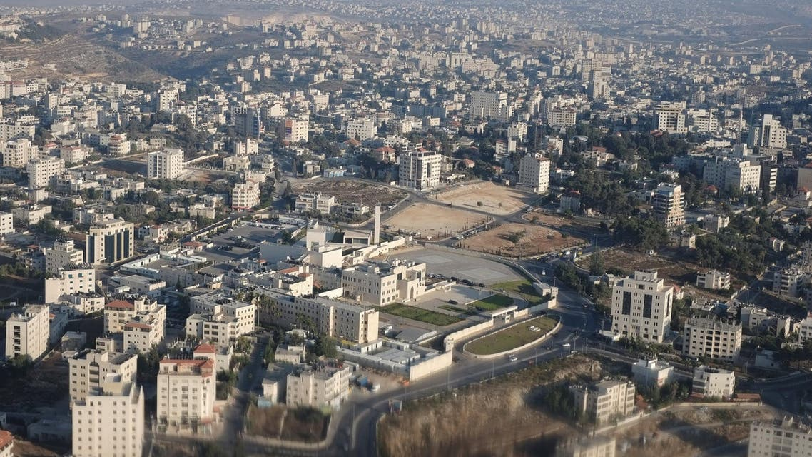 An image take through a helicopter window shows the Mukataa, the headquarters of the Palestinian Authority, on July 19, 2013 in the West Bank city of Ramallah. (AP)