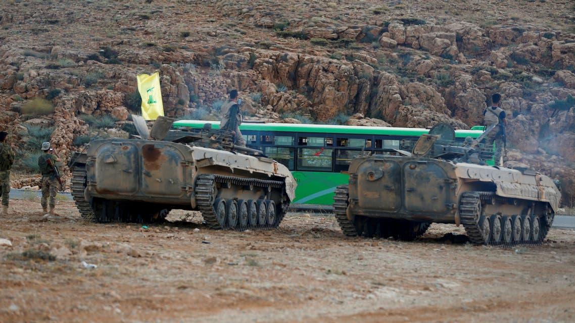 Hezbollah fighters escort buses in Jaroud Arsal in Lebanon on Aug. 2, 2017. reuters