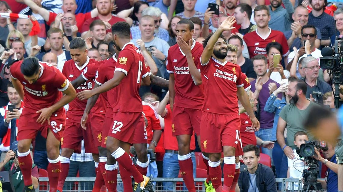 Liverpool's Egyptian midfielder Mohamed Salah (R) celebrates with teammates after scoring their third goal during the English Premier League football match between Liverpool and Arsenal at Anfield in Liverpool, north west England on August 27, 2017. (AFP)