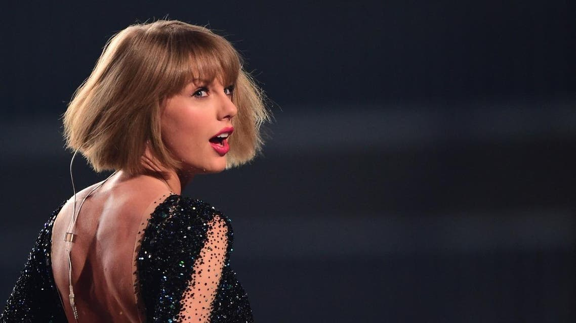 """(FILES) This file photo taken on February 15, 2016 shows singer Taylor Swift performing during the 58th Annual Grammy music Awards in Los Angeles. Taylor Swift, one of the top-selling pop stars of recent years, on August 23, 2017 announced a new album, """"Reputation,"""" to be released on November 10. The 27-year-old singer, who this week has been sharing cryptic videos of a snake showing its fangs, revealed little else about her sixth studio album but said a first single would come out Thursday. (AP)"""