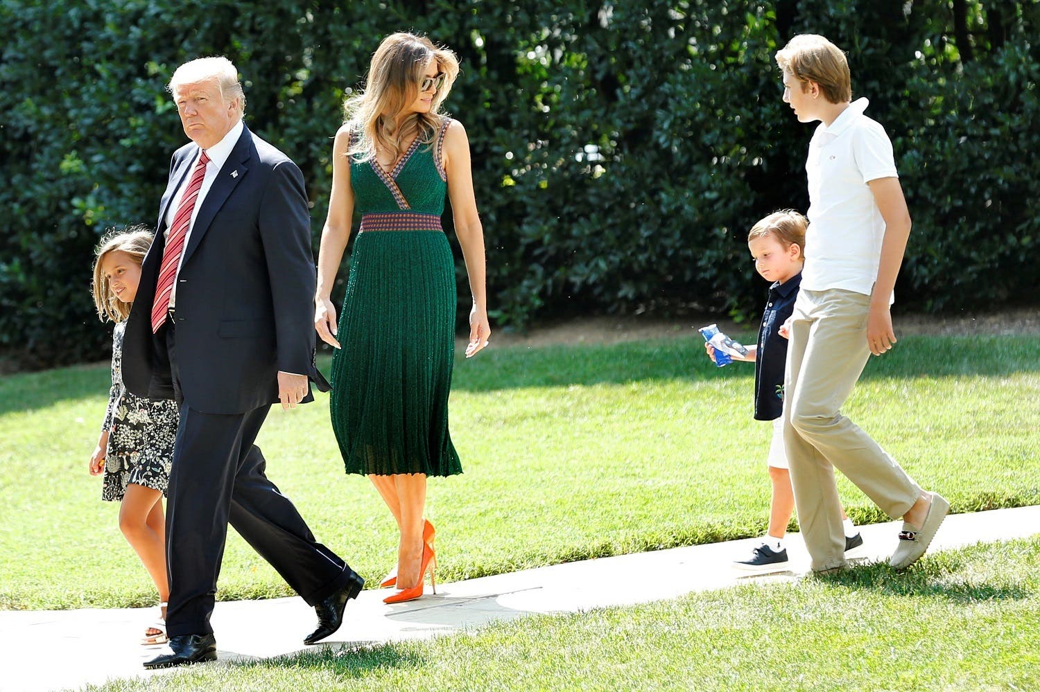 President Donald Trump, First Lady Melania Trump, their son Barron (right) and Trump's grandchildren Arabella and Joseph walk from the Oval Office of the White House in Washington, Ubefore their departure to Camp David, on August 25, 2017. (Reuters)