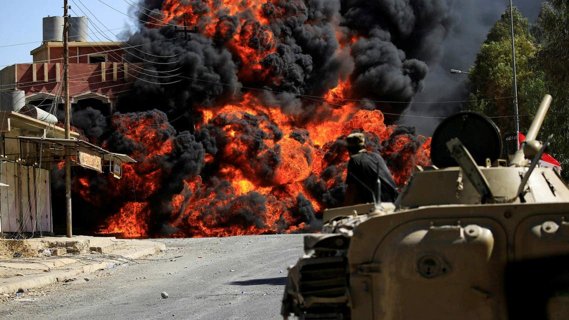 Smoke rises during clashes between joint troop of Iraqi army and Shi'ite Popular Mobilization Forces (PMF) against the Islamic State militants in Tal Afar, Iraq August 26, 2017. reuters