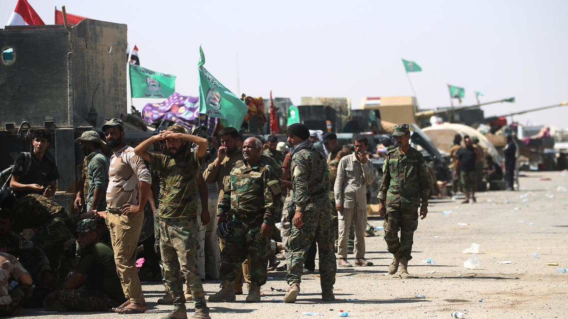 Fighters of Hashed Al-Shaabi (Popular Mobilization units) gather at the Tal Afar airport, west of Mosul, as Iraqi forces backed by local militia and a US-led coalition advanced in driving the Islamic State group from the city, on August 27, 2017. Just a week after authorities announced an offensive to push the jihadists from one of their last major urban strongholds in Iraq, the Joint Operations Command said Iraqi forces held all 29 districts of the city and were pursuing final mopping up operations. Ahmad al-Rubaye / AFP