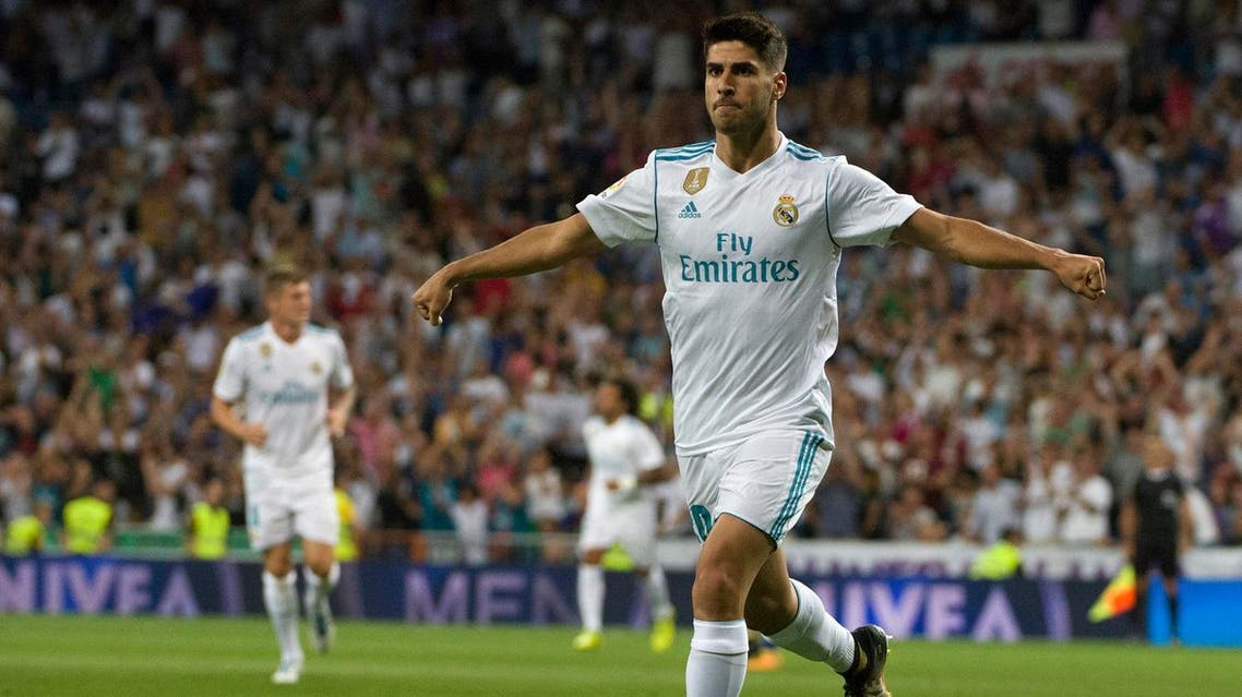 Real Madrid's midfielder Marco Asensio celebrates after scoring during the Spanish league football match Real Madrid CF vs Valencia CF at the Santiago Bernabeu stadium in Madrid on August 27, 2017. (AFP)