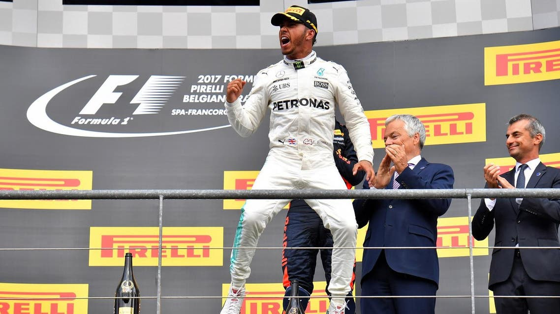 Winner Mercedes' British driver Lewis Hamilton celebrates on the podium after the Belgian Formula One Grand Prix at the Spa-Francorchamps circuit in Spa on August 27, 2017. AFP