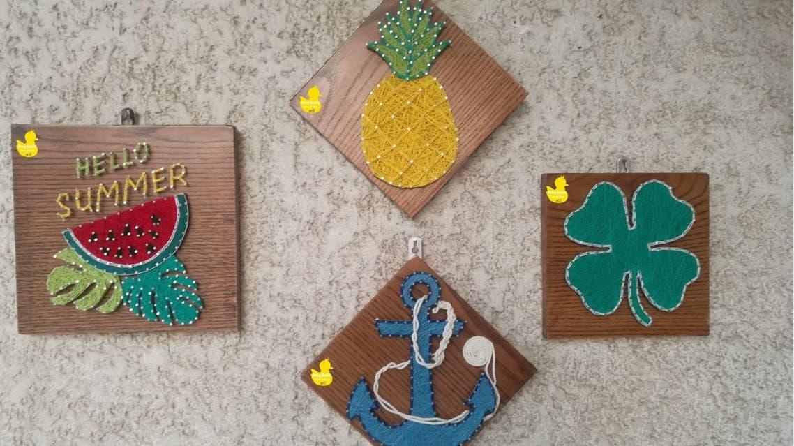 بالمسامير والخشب تنتج لوحاتها ويشتريها فنانو مصر