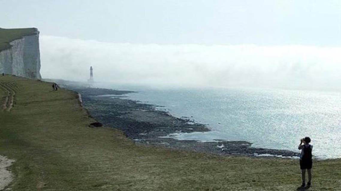 People stand on a cliff at Beachy Head amidst mist, near Eastbourne, Britain August 27, 2017 in this picture obtained from Social Media. Mandatory credit: Louisa Neale via REUTERS ATTENTION EDITORS - THIS IMAGE HAS BEEN SUPPLIED BY A THIRD PARTY. MANDATORY CREDIT. NO RESALES. NO ARCHIVES