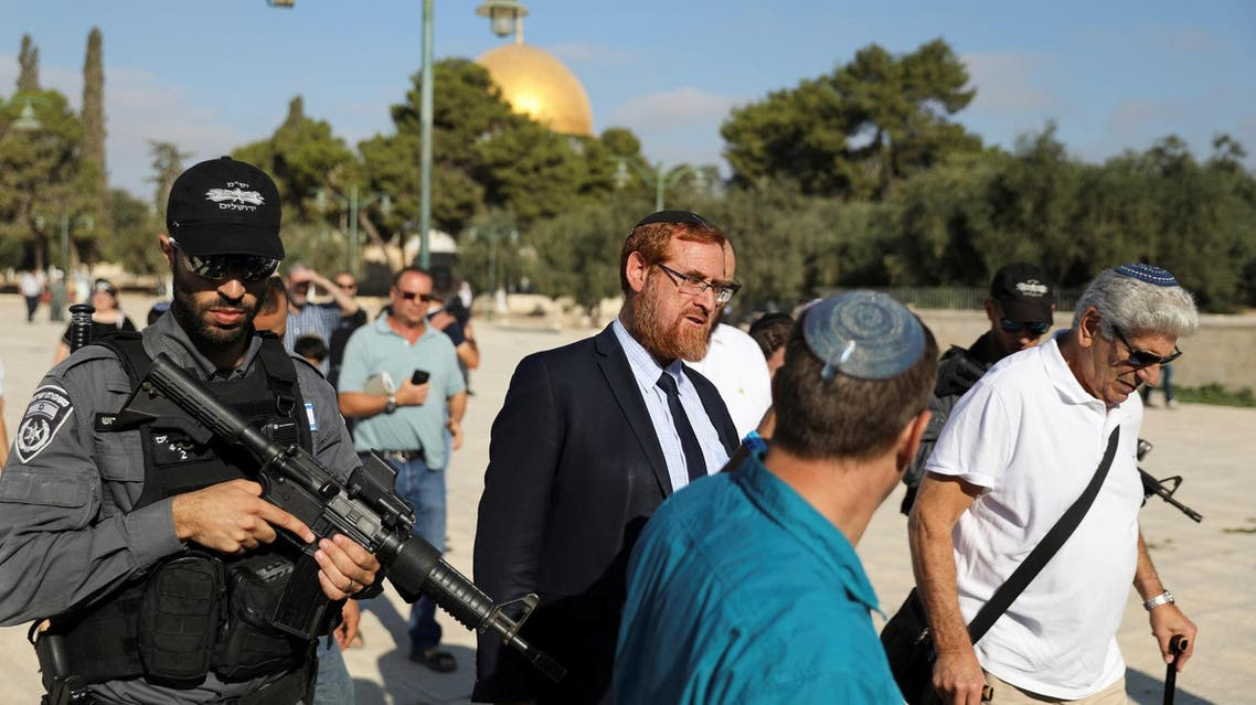 An Israeli policeman escorts Yehuda Glick (C) as he visits the Haram al-Sharif compound in Jerusalem's Old City August 29, 2017. (Reuters)