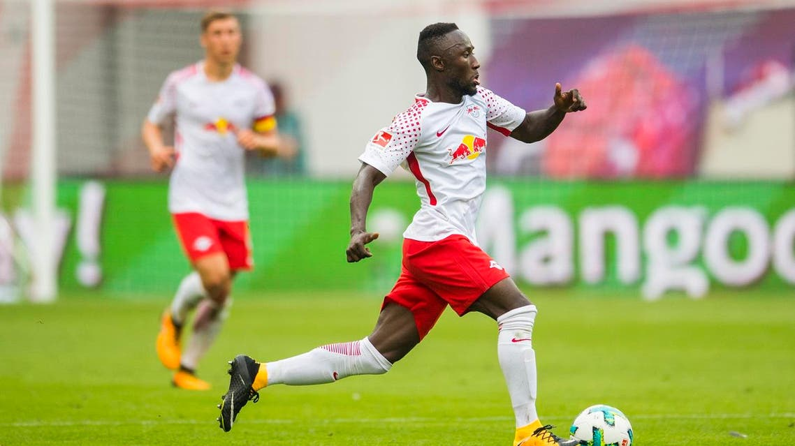 (FILES) This file photo taken on August 27, 2017 shows Leipzig's Guinean midfielder Naby Deco Keita playing the ball during the German first division Bundesliga football match between RB Leipzig and SC Freiburg in Leipzig, eastern Germany. Leipzig and Liverpool have aggreed terms on August 28, 2017 for the sale of the player, starting next season in summer 2018. (AFP)