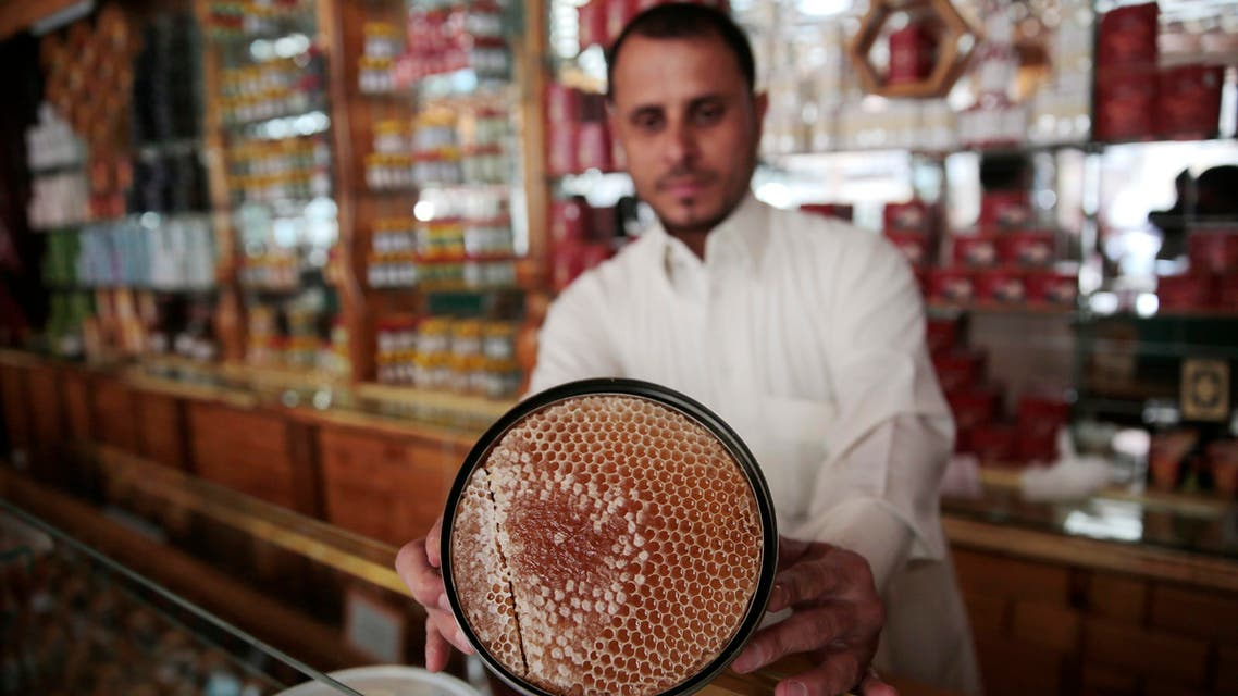 In this Tuesday, Aug. 22, 2017 photo, a Yemeni vendor displays honeycomb for sale in a shop in Sanaa, Yemen. (AP)