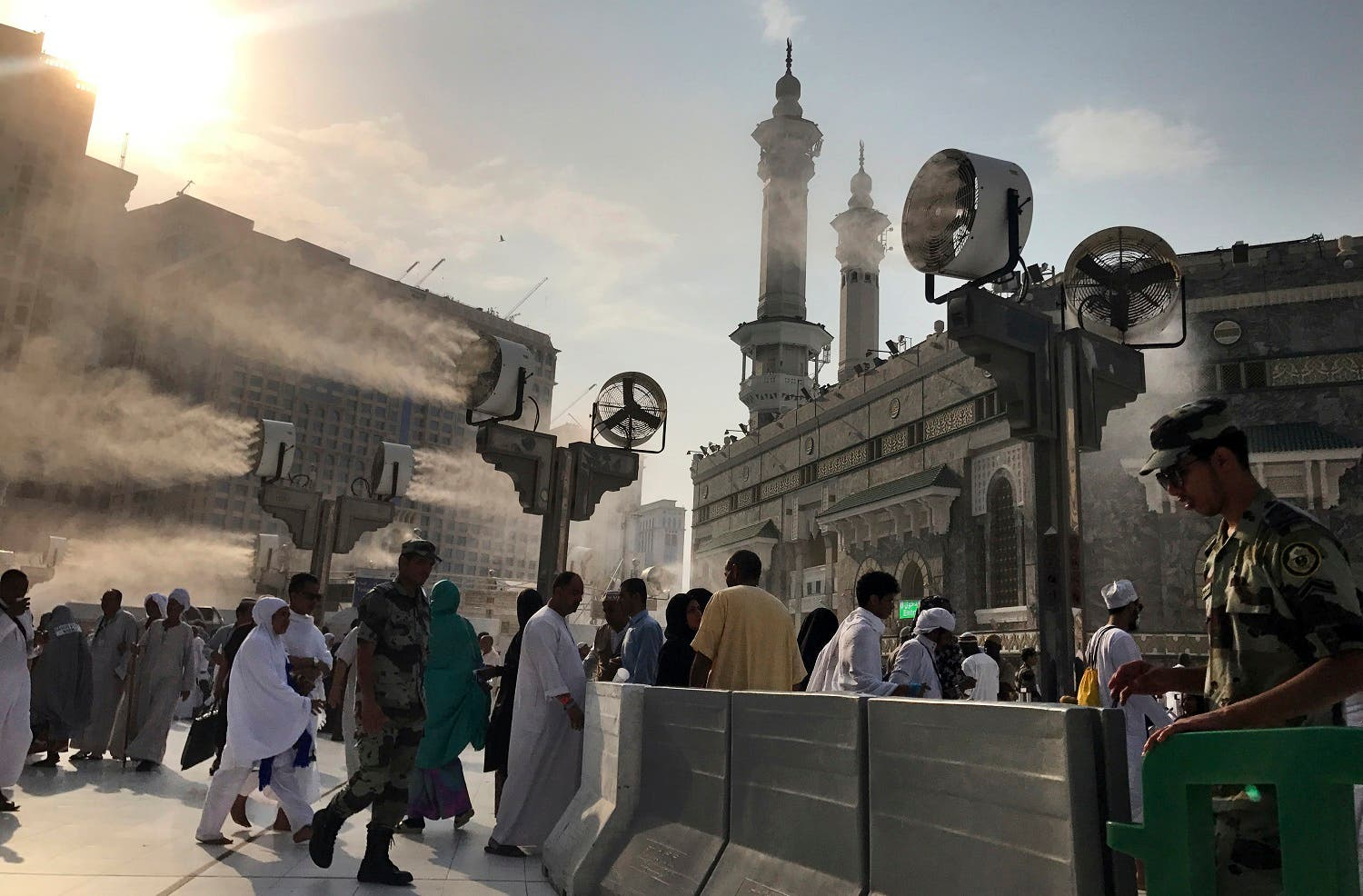 Large cooling fans spray water on Muslim pilgrims around the Grand Mosque ahead of the annual Hajj pilgrimage in the Muslim holy city of Mecca, Saudi Arabia, Tuesday, Aug. 29, 2017. (AP)