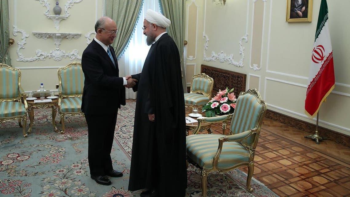 President Hassan Rouhani (R) greeting Yukiya Amano (L), Director General of the IAEA, in Tehran on December 18, 2016. (AFP)