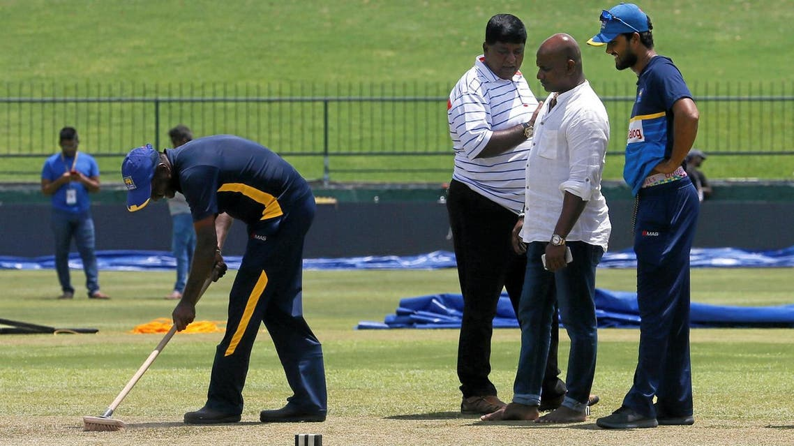 Sri Lanka's cricket team captain Dinesh Chandimal and chairman of selection committee Sanath Jayasuriya inspect the pitch ahead of their final test match against India. (Reuters)