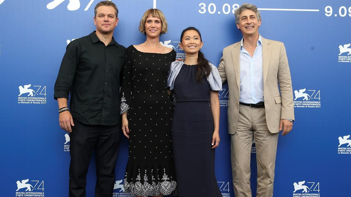 """Director Alexander Payne with actors Matt Damon, Kristen Wiig and Hong Chau during a photocall for """"Downsizing"""" at the 74th Venice Film Festival on  August 30, 2017. (Reuters)"""