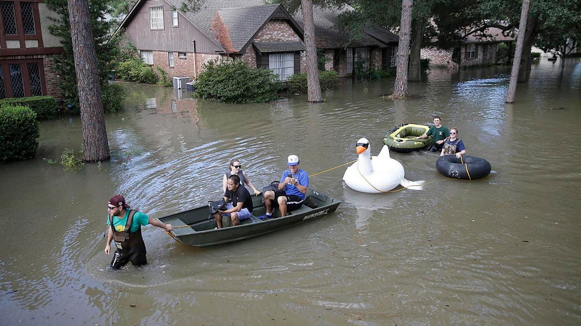 Families evacuate from their homes in Lakeside Estate in Houston, Texas on August 30, 2017.(AFP)
