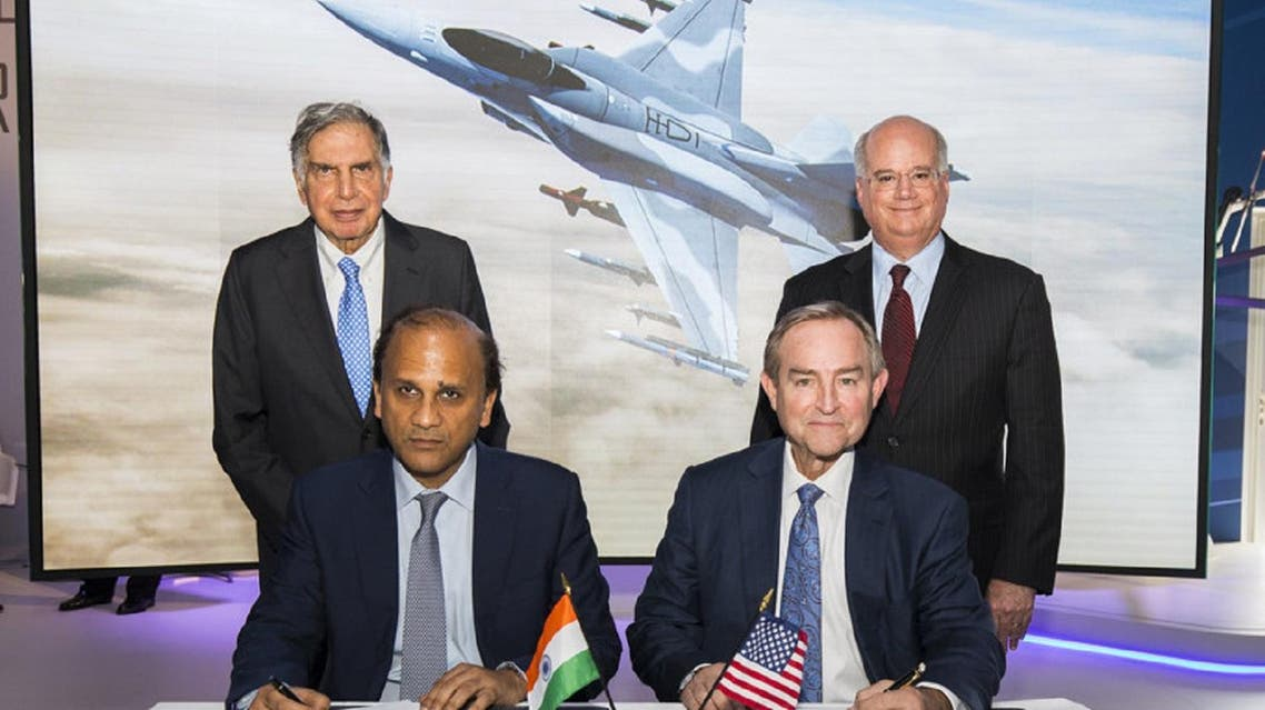 Sukaran Singh, CEO of Tata Advanced Systems Limited, (seated left) and George Standridge, vice president of Strategy and Business Development, Lockheed Martin Aeronautics, sign a letter of intent to produce the F-16 Block 70 in India. Standing are Ratan Tata, Chairman Emeritus, Tata Sons, and Orlando Carvalho, executive vice president of Lockheed Martin Aeronautics. (Courtesy: Lockheed Martin)
