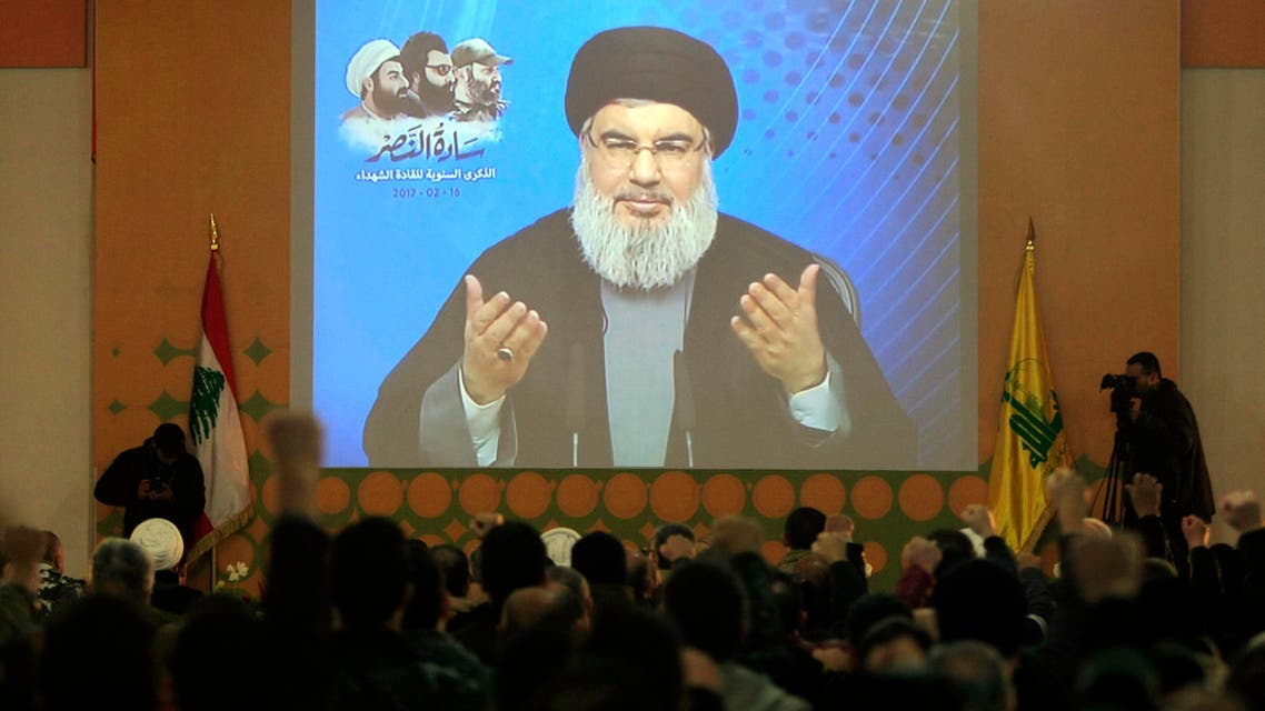 Hezbollah leader Sayyed Hassan Nasralla, who is seen speaking through a video link during a ceremony to honer fallen Hezbollah leaders, in Teir Debba village, south Lebanon, Thursday, Feb. 16, 2017. (AP)