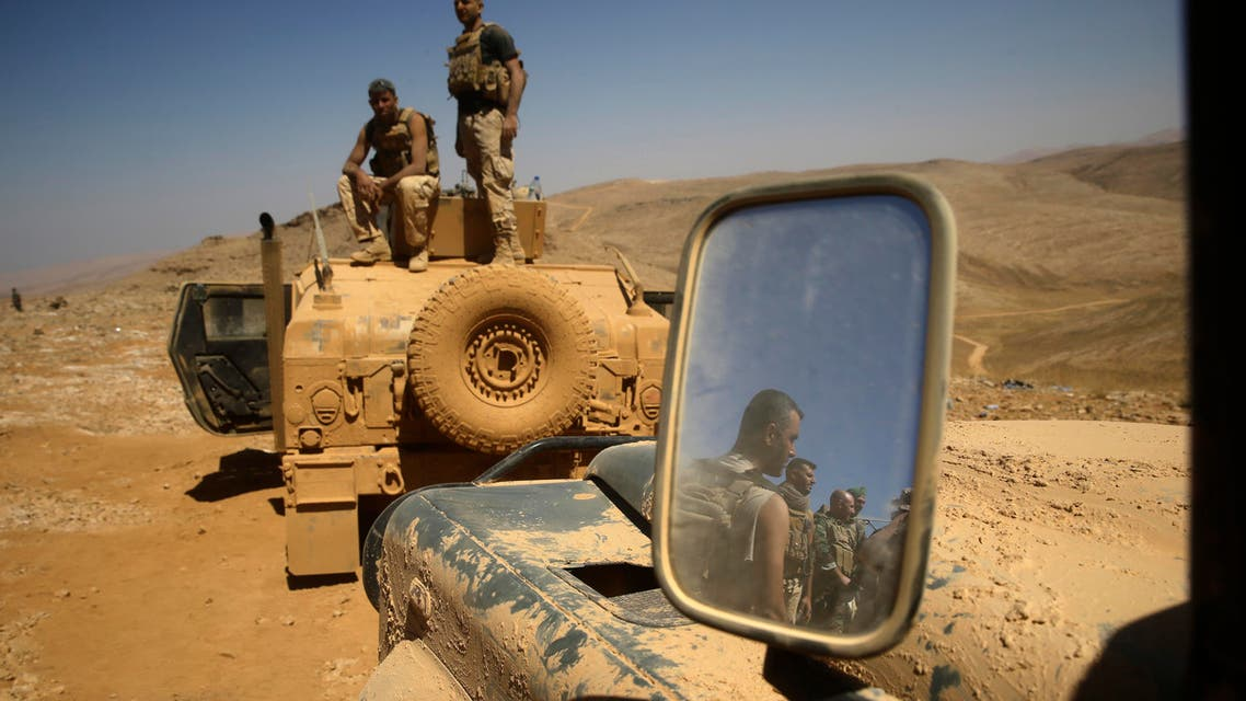 Lebanese soldiers rest on top of an armored personnel carrier during a media trip organized by the Lebanese army, on the outskirts of Ras Baalbek, northeast Lebanon, Monday, Aug. 28, 2017. (ap)