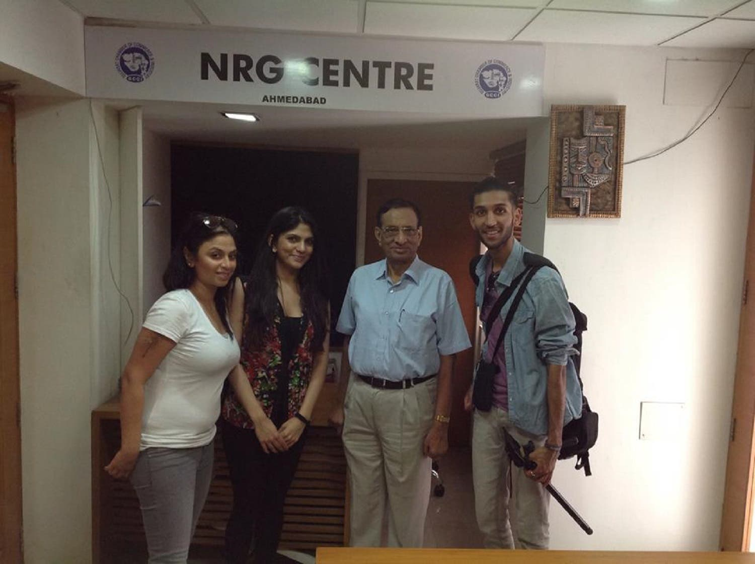Non-resident Indians visiting Ahmedabad throng Kulin Patel's (second from right) office for help and guidance on various issues. (Supplied)