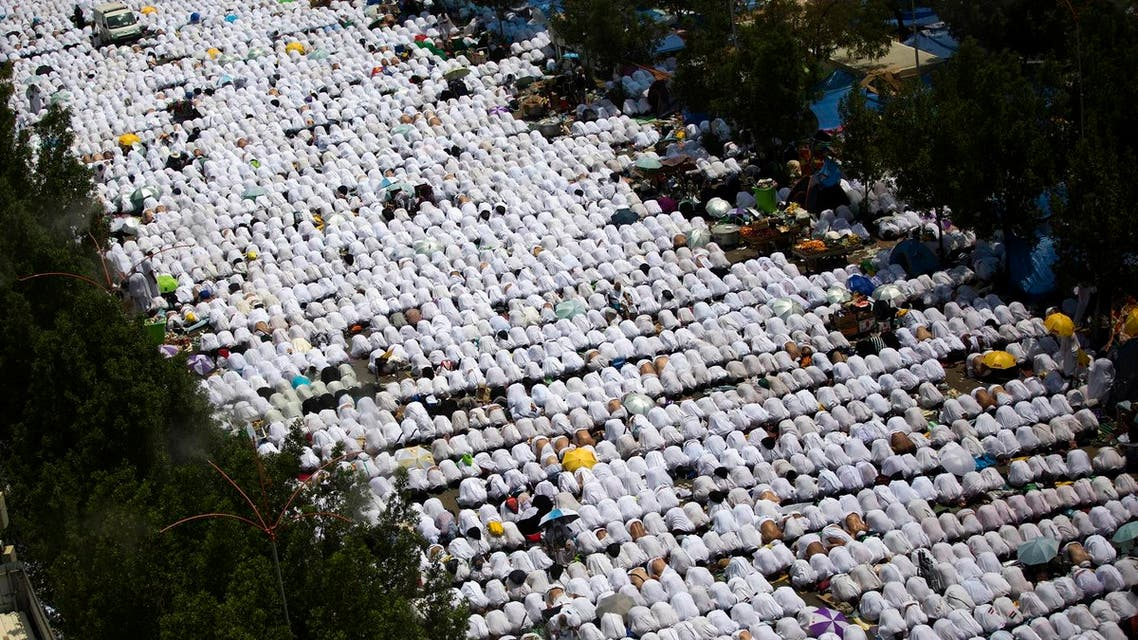 Muslim pilgrims attend noon prayers outside the Namirah mosque on Arafat Mountain, during the annual hajj pilgrimage, outside the holy city of Mecca, Saudi Arabia, Thursday, Aug. 31, 2017. AP