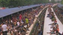 WATCH: Bangladeshis swarm trains for Eid al-Adha