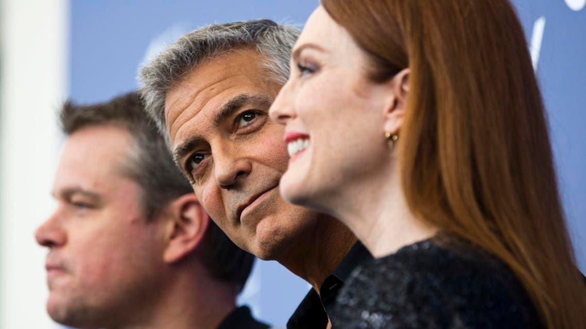 """Actor George Clooney, center, poses with actors, Julianne Moore, right, and Matt Damon during the photo call for the film """"Suburbicon"""" at the 74th Venice Film Festival on Sept. 2, 2017. (AP)"""