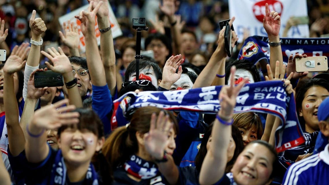 Japan's soccer fans wave to their players after Japan won the match against Australia at Saitama Stadium 2002, in Japan on August 31, 2017. (Reuters)