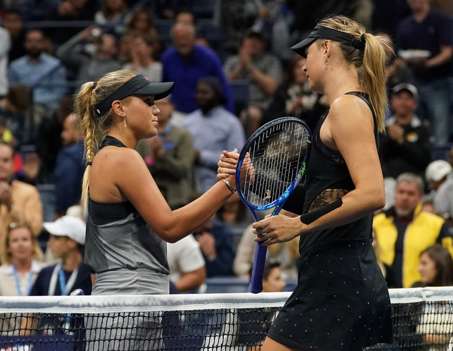 Maria Sharapova of Russia shakes hands with Sofia Kenin of the USA in Ashe Stadium after their match. (Robert Deutsch-USA TODAY Sports/Reuters)