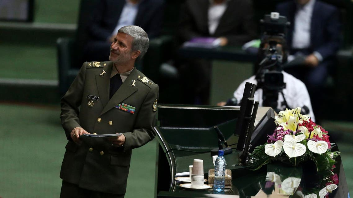 Gen. Amir Hatami arrives at the podium to defend himself in a session of parliament in Tehran, on Aug. 17, 2017. (AP)