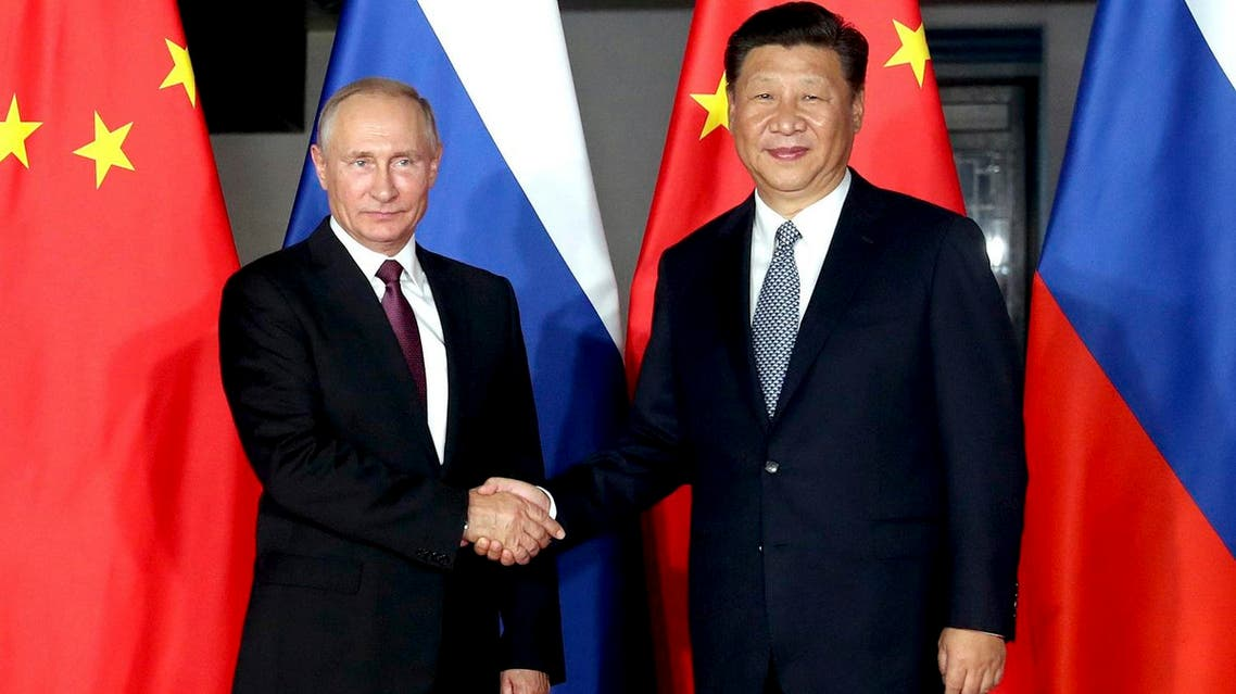 Russian President Vladimir Putin shake hands with Chinese President Xi Jinping during their meeting on the sidelines of the BRICS Summit in Xiamen, on Sept. 3, 2017. (AP)