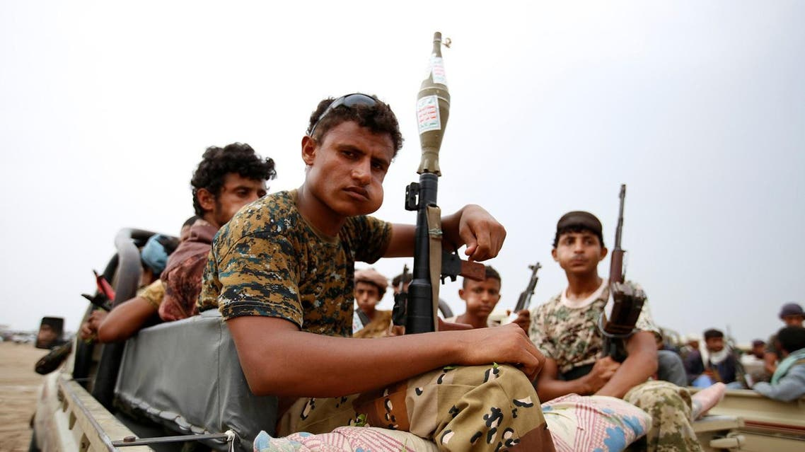Houthi fighters ride on the back of a truck during a parade in the Red Sea port city of Hodeidah, Yemen August 24, 2017. REUTERS/Abduljabbar Zeyad