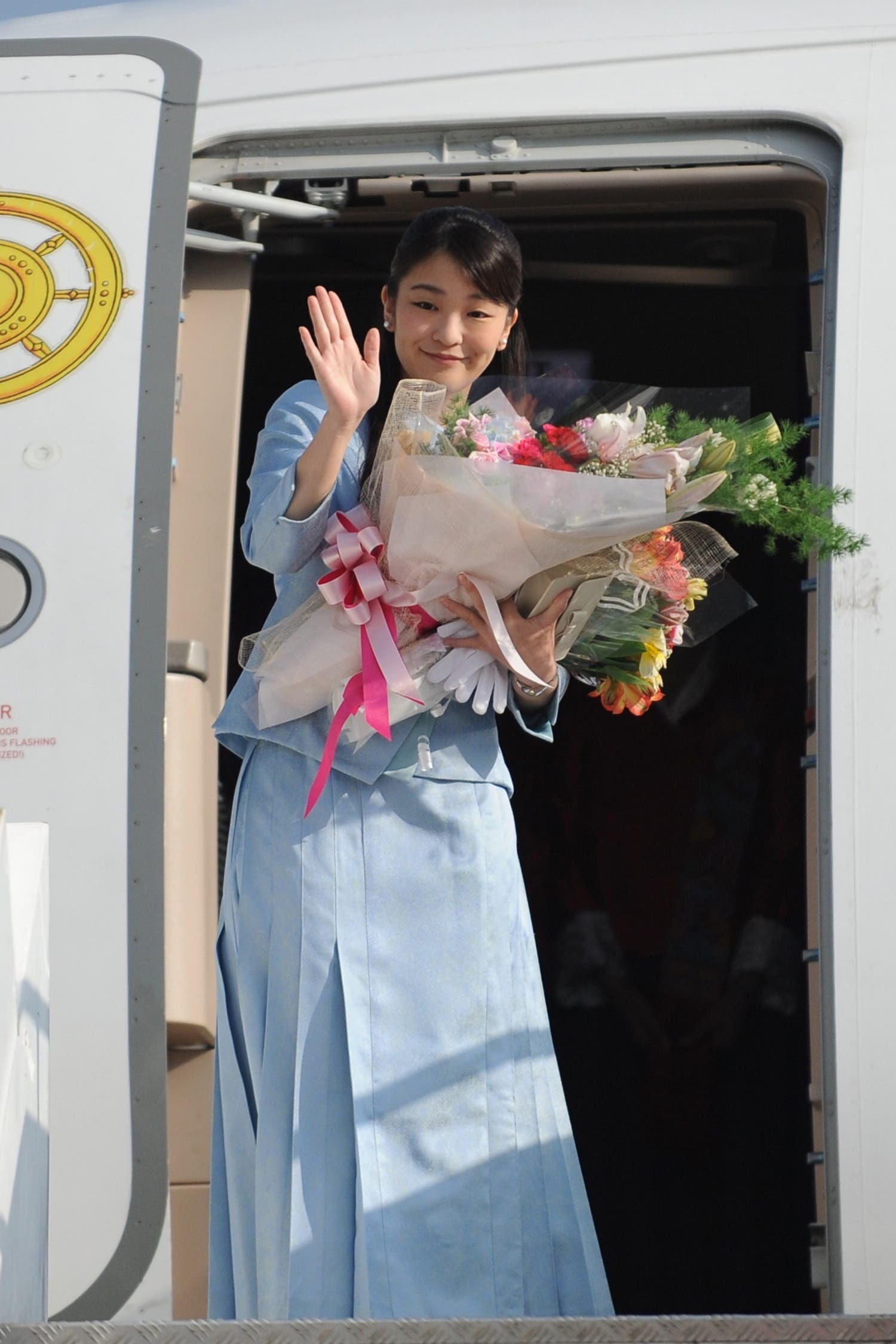 Princess Mako waves prior to her departure from Paro Airport in Bhutan on June 7, 2017. (AFP)