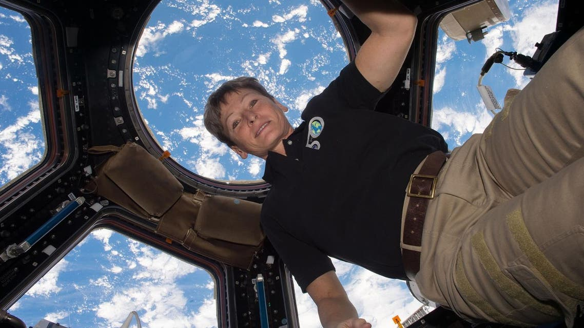 This undated NASA handout photo released on April 24, 2017 shows NASA astronaut Peggy Whitson aboard the International Speace Station. NASA astronaut Peggy Whitson flew through the standing record for cumulative time spent in space by a US astronaut at 1:27 a.m. EDT on April 24, 2017, and with the recent extension of her stay at the International Space Station, she has five months to rack up a new one. (AFP)