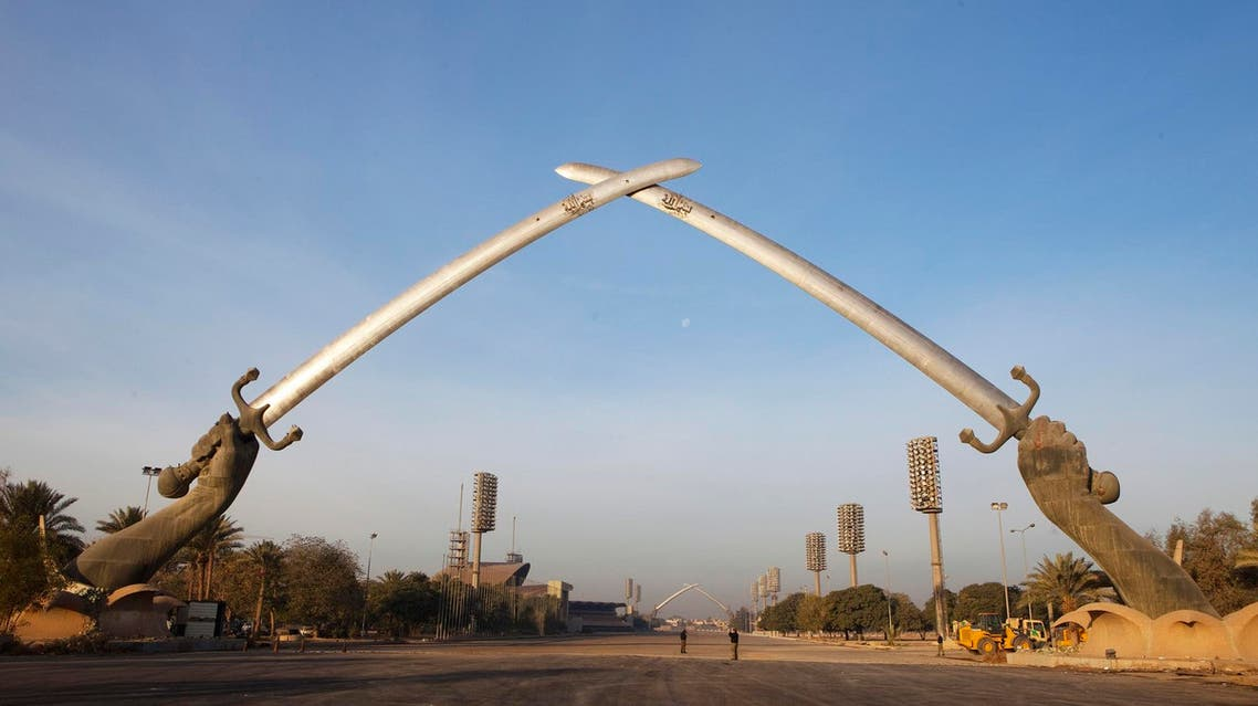 """The """"Hands of Victory"""" memorial rises over an empty parade ground in the Green Zone of Baghdad December 14, 2011. (Reuters)"""