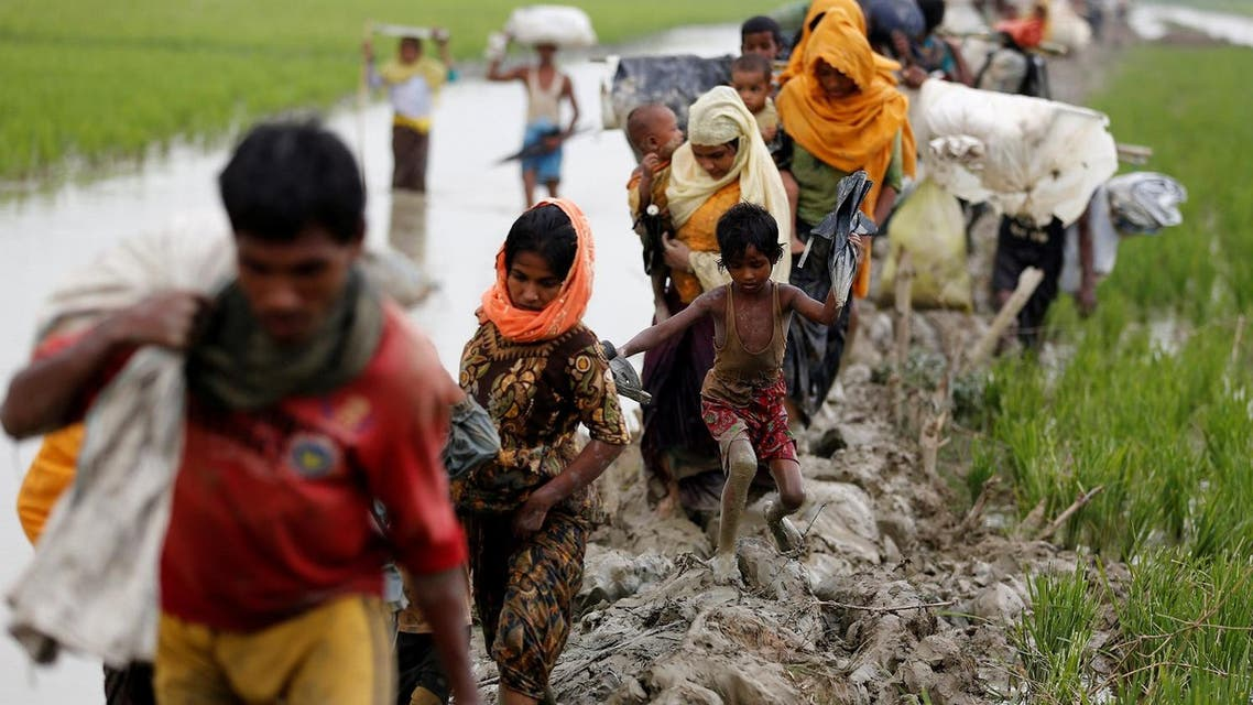 Rohingya refugees walk on the muddy path after crossing the Bangladesh-Myanmar border in Teknaf, Bangladesh, September 3, 2017. (Reuters)