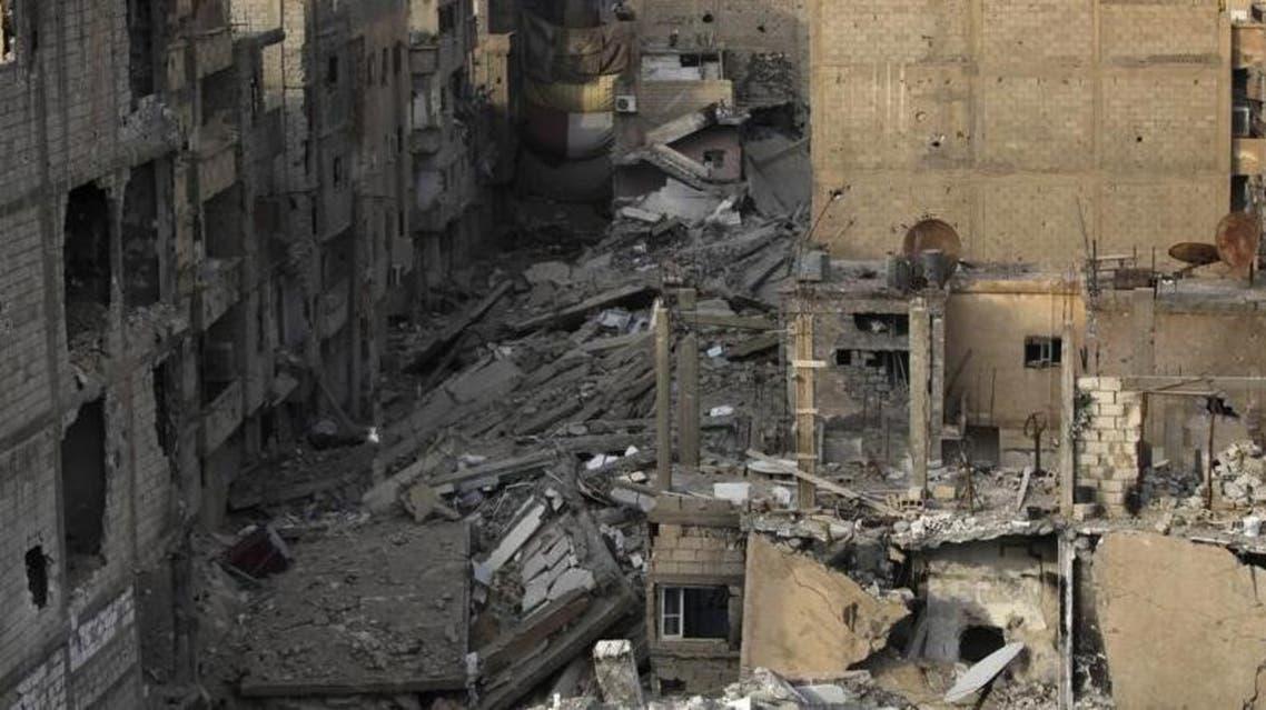 مباني مدمرة في دير الزور