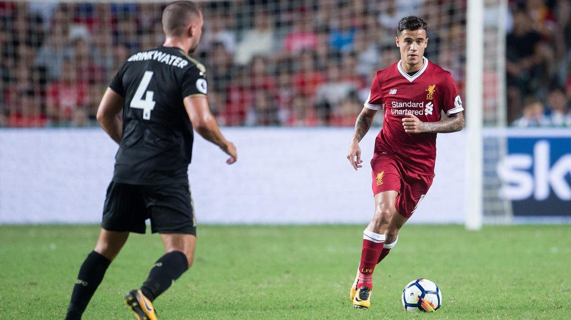 Liverpool's Philippe Coutinho (R) controls the ball during the final of the Premier League Asia Trophy football tournament between Liverpool and Leicester City in Hong Kong on July 22, 2017. (AFP)