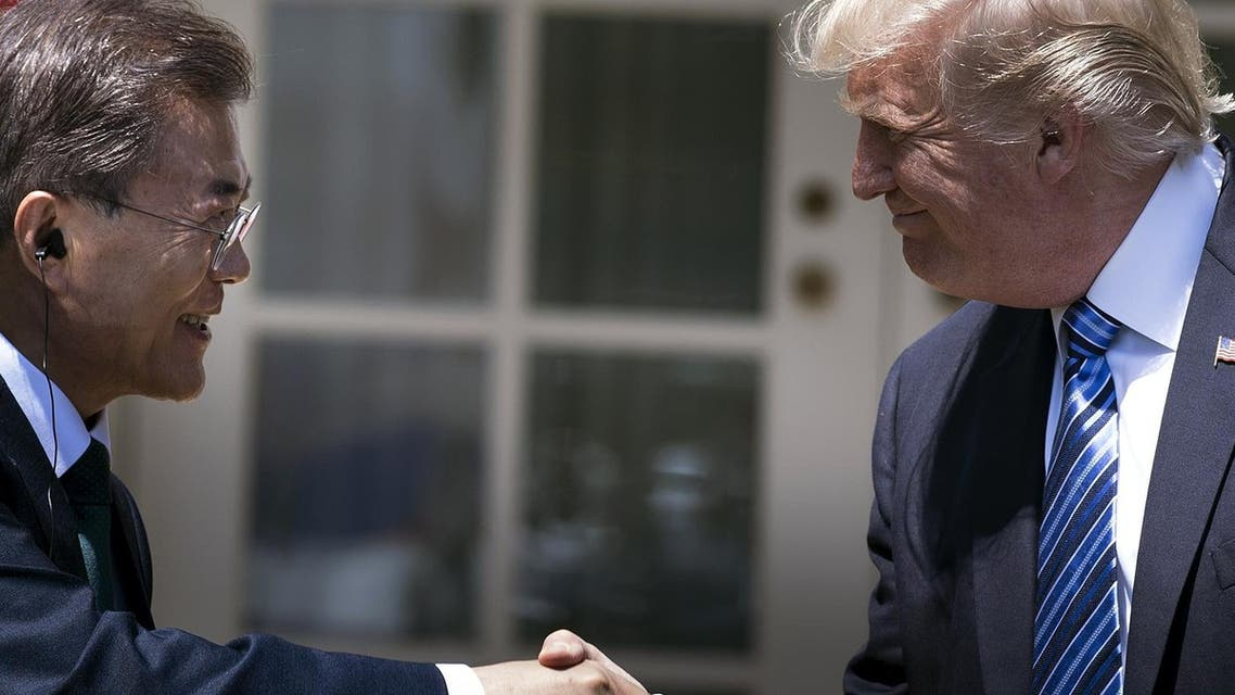 South Korea's President Moon Jae-in and US President Donald Trump shaking hands in the Rose Garden of the White House in Washington, DC. Trump and Moon agreed on September 4, 2017. AFP