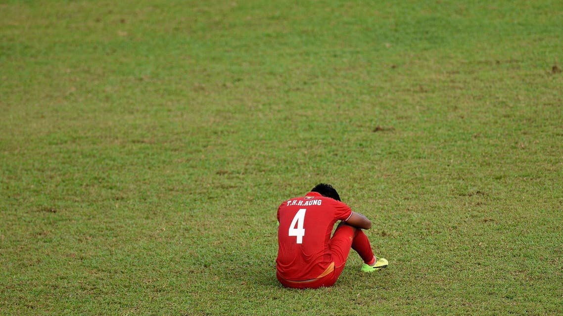 Myanmar's Thiha Htet Aung(R) sits dejected on the field after losing to Thailand during their men's football semi-final match of the 29th Southeast Asian Games (SEA Games) at Selayang Stadium, outside Kuala Lumpur on August 26, 2017. AFP