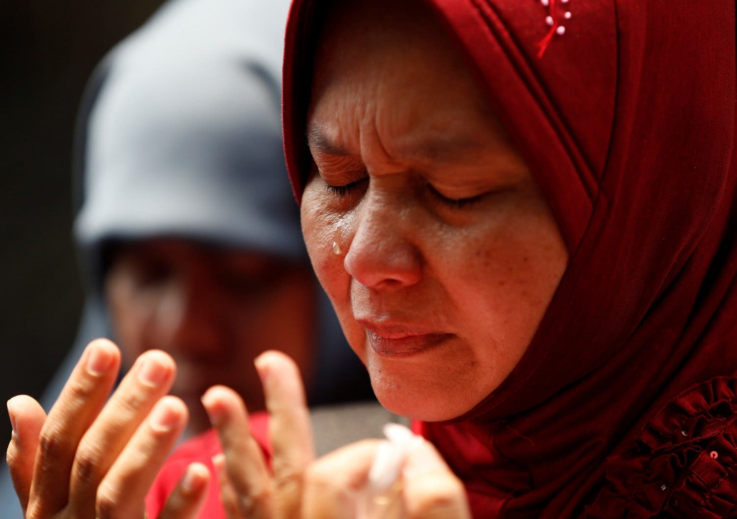 A Muslim woman cries during prayers at the end of a rally in support of Myanmar's Rohingya minority during one of the deadliest bouts of violence involving the Muslim minority in decades outside the Myanmar embassy in Jakarta, Indonesia, September 4, 2017. (Reuters)