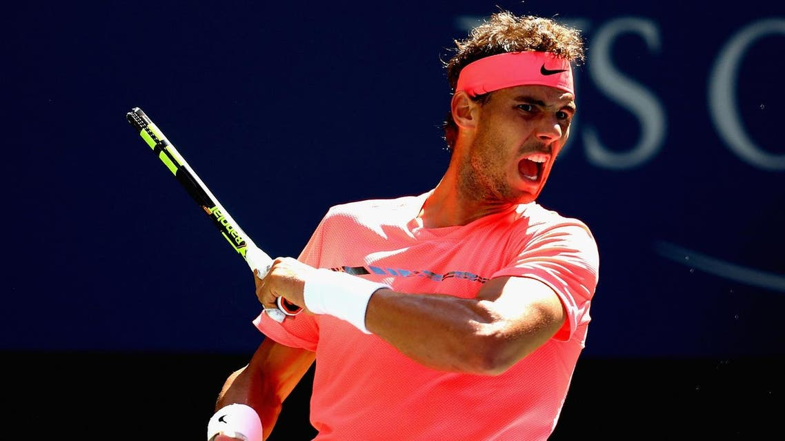 NEW YORK, NY - SEPTEMBER 04: Rafael Nadal of Spain returns a shot against Alexandr Dolgopolov of Ukraine during their fourth round Men's Singles match on Day Eight of the 2017 US Open at the USTA Billie Jean King National Tennis Center on September 4, 2017 in the Flushing neighborhood of the Queens borough of New York City. Al Bello/Getty Images/AFP