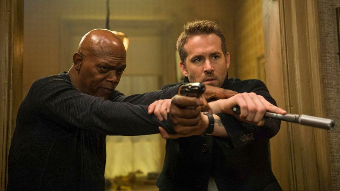 """This image released by Lionsgate shows Samuel L. Jackson, left, and Ryan Reynolds in """"The Hitman's Bodyguard."""" ("""