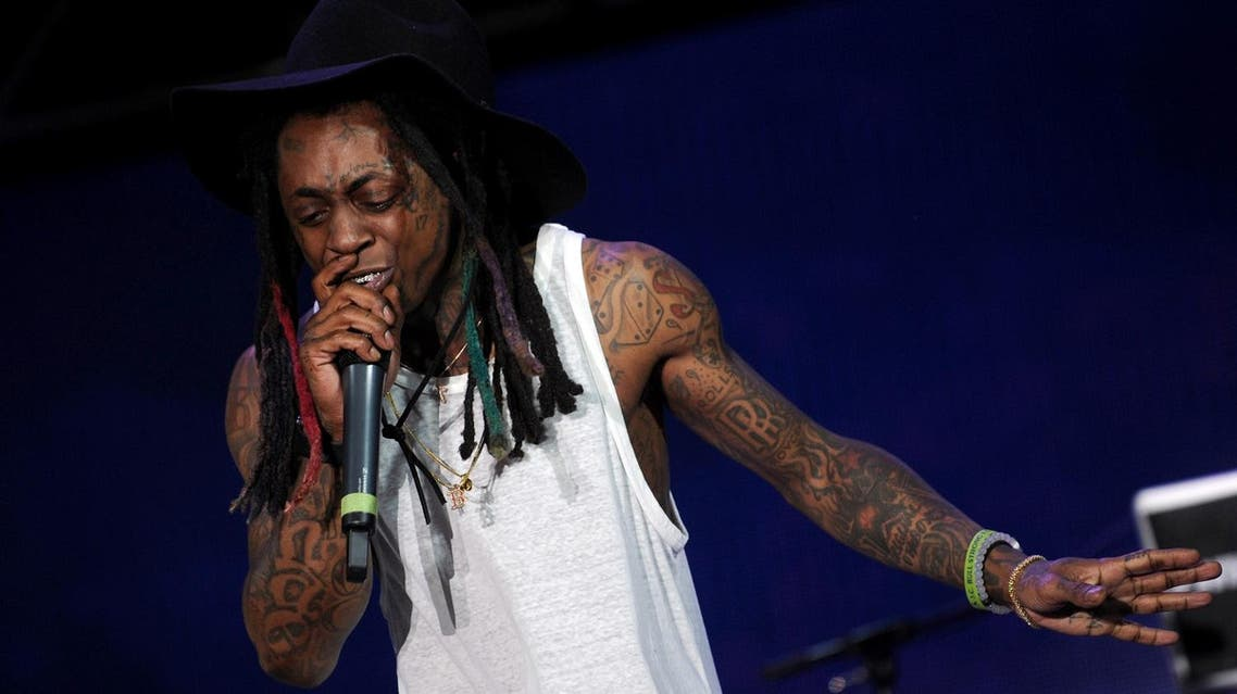 (FILES) This file photo taken on June 26, 2015 shows rapper Lil Wayne performing during a free concert in Champ de Mars in Port-au-Prince. Lil Wayne has been hospitalized in Chicago after suffering multiple epileptic seizures, celebrity news site TMZ reported. The online outlet said Lil Wayne was found unconscious in his hotel room on September 3, 2017, and was rushed to Northwestern Memorial hospital. (AFP)