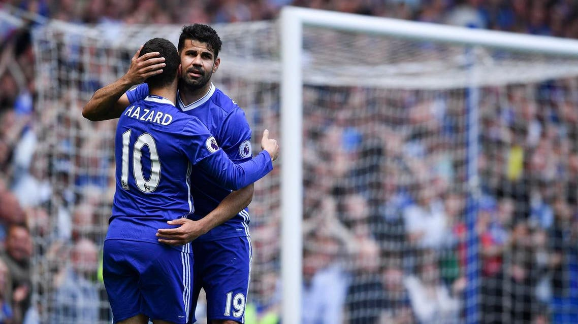 Chelsea's Belgian midfielder Eden Hazard (L) emabraces Chelsea's Brazilian-born Spanish striker Diego Costa (R) after scoring their second goal during the English Premier League football match between Chelsea and Sunderland at Stamford Bridge in London on May 21, 2017. (AFP)