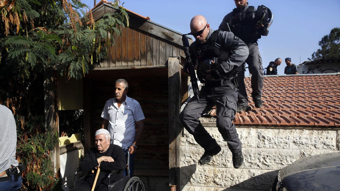 Israeli police officers evacuate a Palestinian member of the Shamasneh family in east Jerusalem Tuesday, Sept. 5, 2017. (AP)