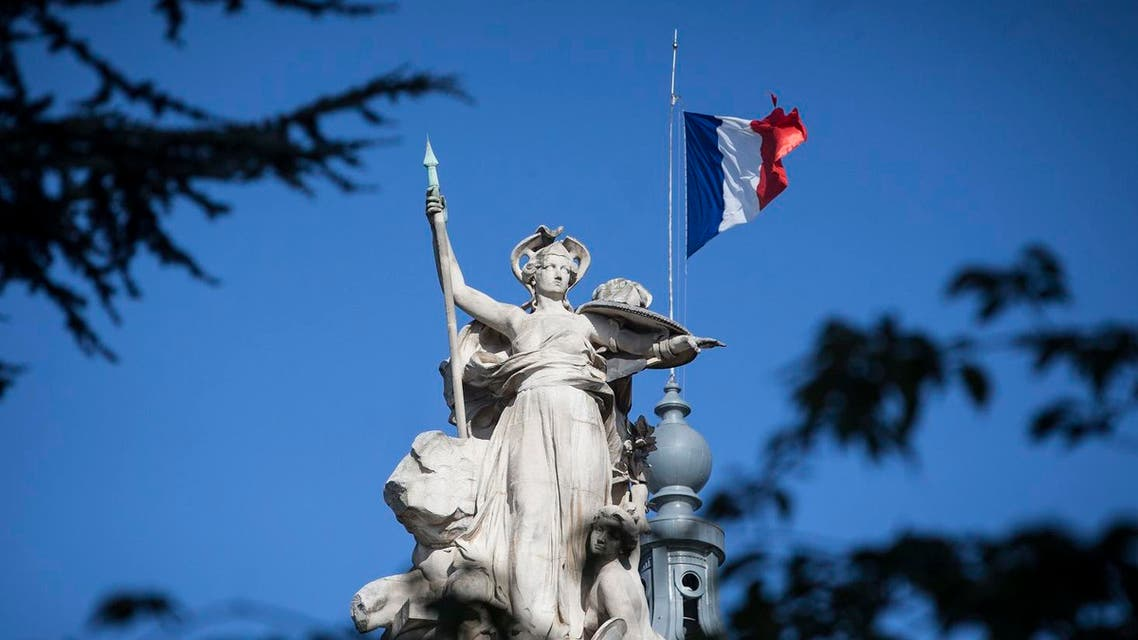 A French flag flies at half-staff on the Grand Palais in Paris, Saturday, Aug. 19, 2017. (AP)