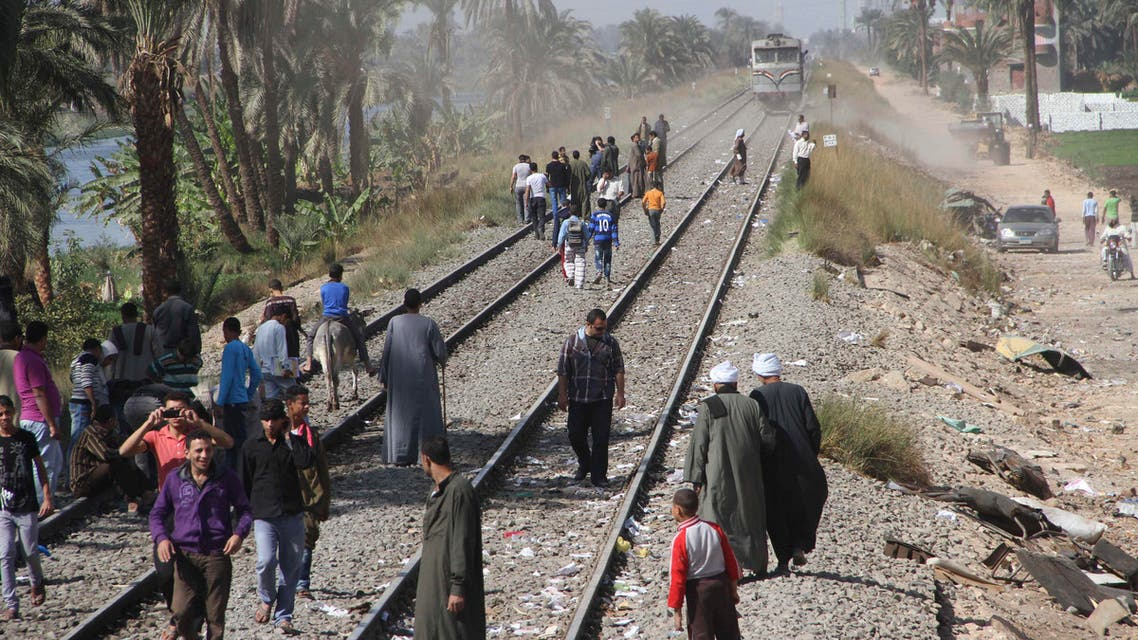 Egyptians block the tracks in protest as they gather at the site of a train crash that killed at least 51 people, most of them children between 4 and 6 years old, near Assiut in southern Egypt, in Cairo, Egypt, Sunday, Nov. 18, 2012. AP