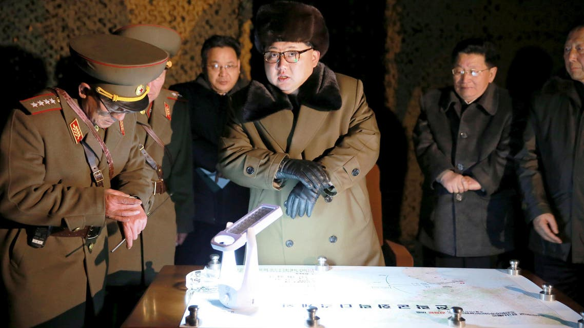 FILE PHOTO: North Korean leader Kim Jong Un talks with officials at the ballistic rocket launch drill of the Strategic Force of the Korean People's Army (KPA) at an unknown location, in this undated photo released by North Korea's Korean Central News Agency (KCNA) in Pyongyang on March 11, 2016. REUTERS/KCNA/File Pix ATTENTION EDITORS - THIS PICTURE WAS PROVIDED BY A THIRD PARTY. REUTERS IS UNABLE TO INDEPENDENTLY VERIFY THE AUTHENTICITY, CONTENT, LOCATION OR DATE OF THIS IMAGE. FOR EDITORIAL USE ONLY. NOT FOR SALE FOR MARKETING OR ADVERTISING CAMPAIGNS. NO THIRD PARTY SALES. NOT FOR USE BY REUTERS THIRD PARTY DISTRIBUTORS. SOUTH KOREA OUT. NO COMMERCIAL OR EDITORIAL SALES IN SOUTH KOREA. THIS PICTURE IS DISTRIBUTED EXACTLY AS RECEIVED BY REUTERS, AS A SERVICE TO CLIENTS