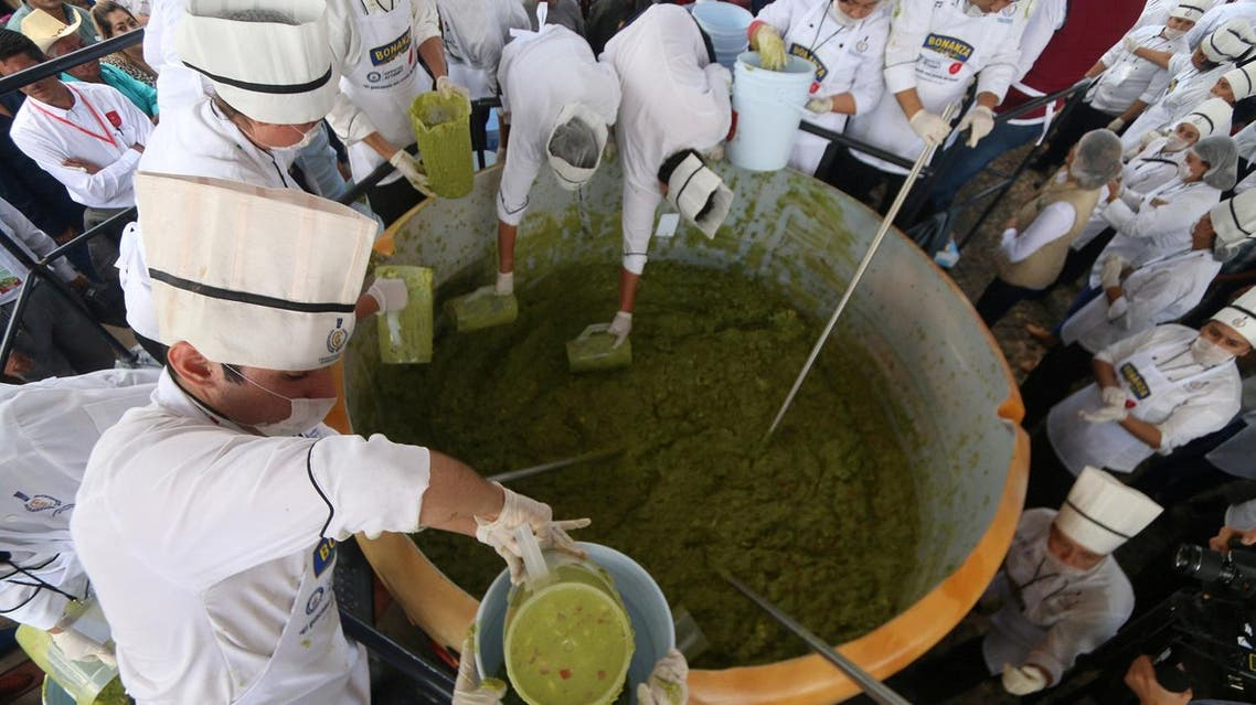 Volunteers from a culinary school mix mashed avocados as they attempt to set a new Guinness World Record for the largest serving of guacamole in Concepcion de Buenos Aires, Jalisco, Mexico September 3, 2017. REUTERS