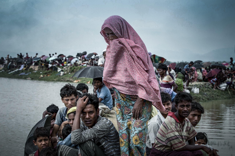 Displaced Rohingya refugees from Rakhine state in Myanmar rest near Ukhia, near the border between Bangladesh and Myanmar. (K.M. ASAD / AFP)